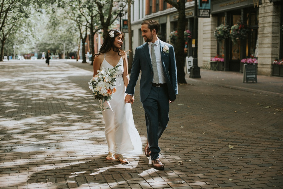 couple walking through pioneer square