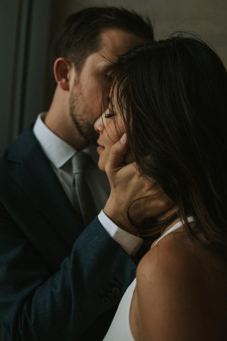 groom kissing bride gently