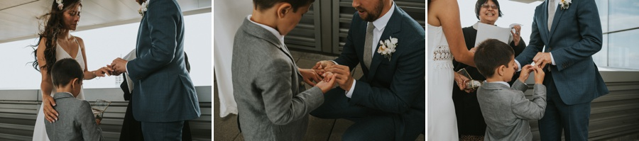 bride and groom putting on rings