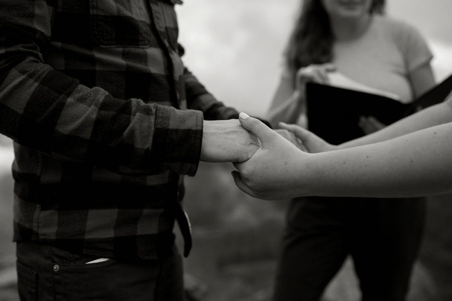 holding hands during elopement ceremony