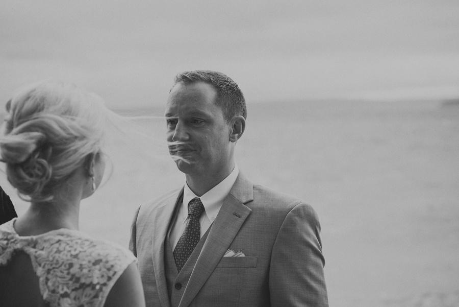 groom lovingly looking at bride