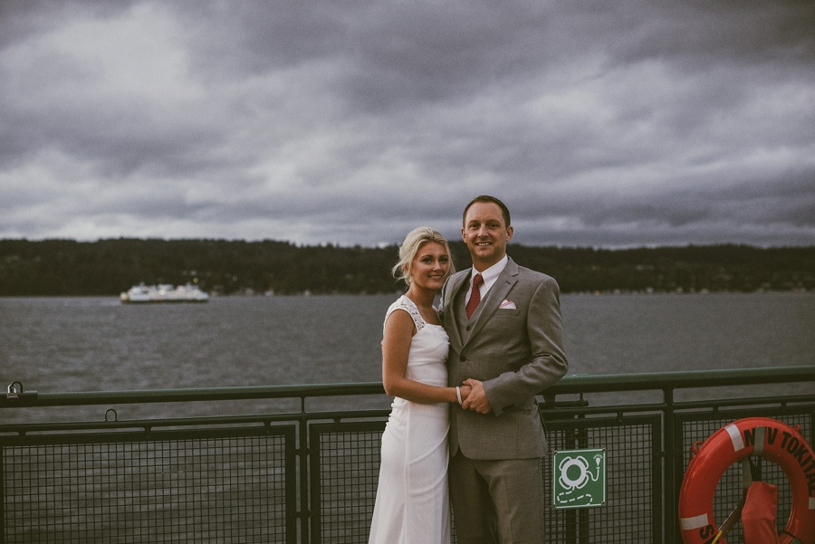 couple on ferry after wedding