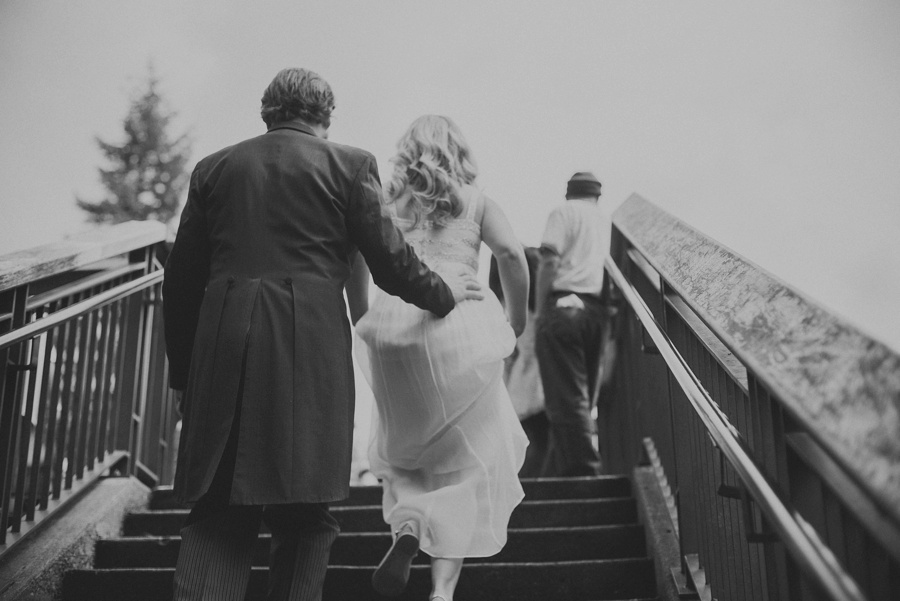 bride and groom walking up stairs
