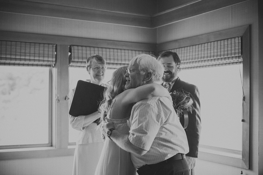 bride hugging father during elopement ceremony