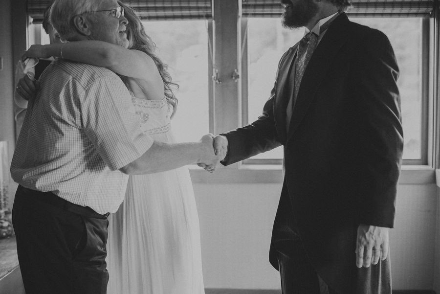 groom shaking father in laws hand