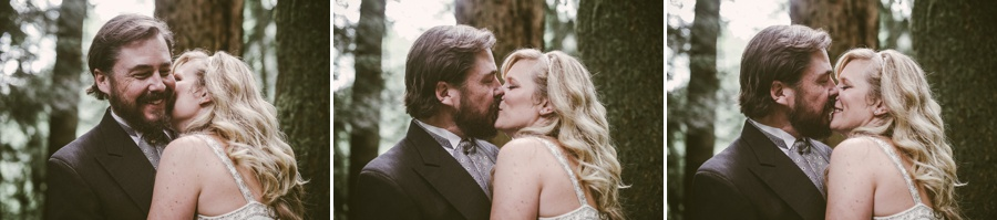 bride and groom kissing at snoqualmie falls elopement