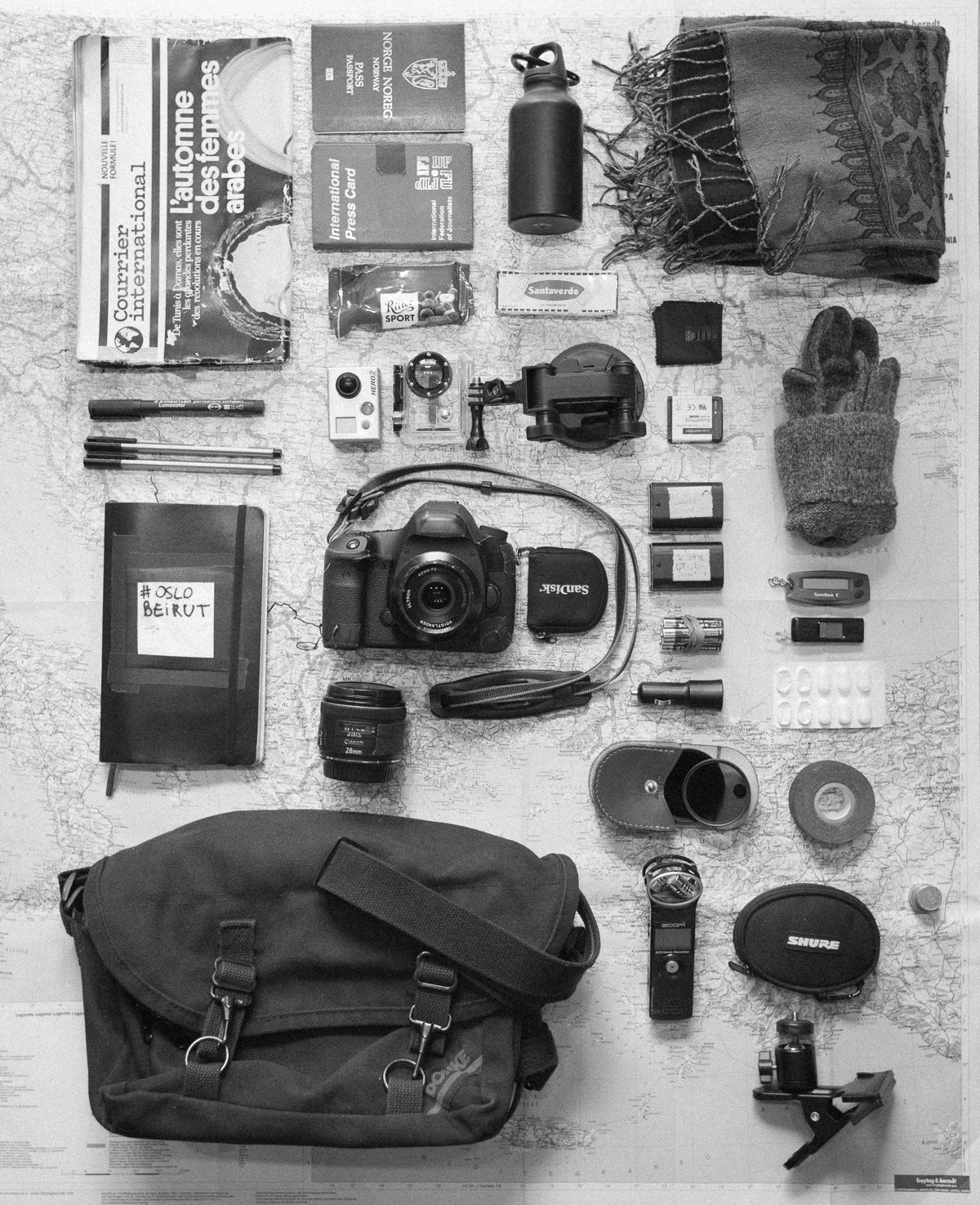 Here's what I'm carrying around in my handbag these days.    Courrier International, presscard, passport, water, scarf, chocolate, plaster, microfiber cloth, marker and pens, go pro hero 2 + suction mount and spare battery, gloves, travel diary / notebook, Canon 5Dmk3 + memory cards + 2 batteries + 40mm lens + 28mm lens, AA batteries, bank thing, USB key, painkillers, car charger for cellphone, filters in a box, gaffer tape, sound recording device, earphones, coins, ballhead clamp for camera, map of Eastern Europe and Turkey. Wallet and cellphone are in jeans pockets.  (DOMKE F6)   #insidemybag by  Sébastian Dahl  on  Angles