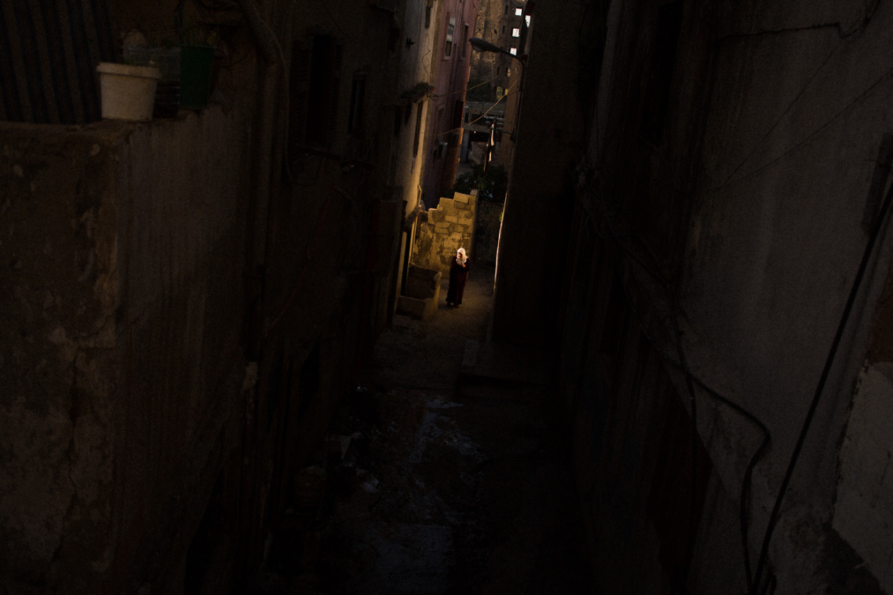 Tripoli (Lebanon) January 14th 2013.   An old woman walking in a side street between an Alawi and a Sunni neighborhood.