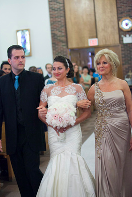 Walking down the aisle with my mom and brother