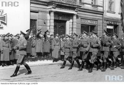 """Photo: Generals: Walter Somme, Ernst Boepple and Richard Wendler (far right on the podium) on Adolf Hitler square in Krakow (now Market Square) during the """"Day of the fallen heroes"""" parade (source:    nick.salon24.pl/589670,ss-gruppenf-hrer-wendler-i-skrzynie-lupow-z-polskich-kosciolow   )"""
