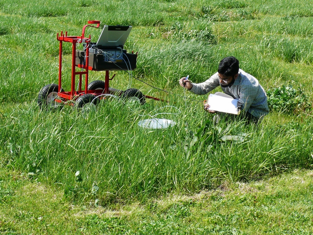 Javed Iqbal measuring trace gas in Lexington, KY tall fescue plots.