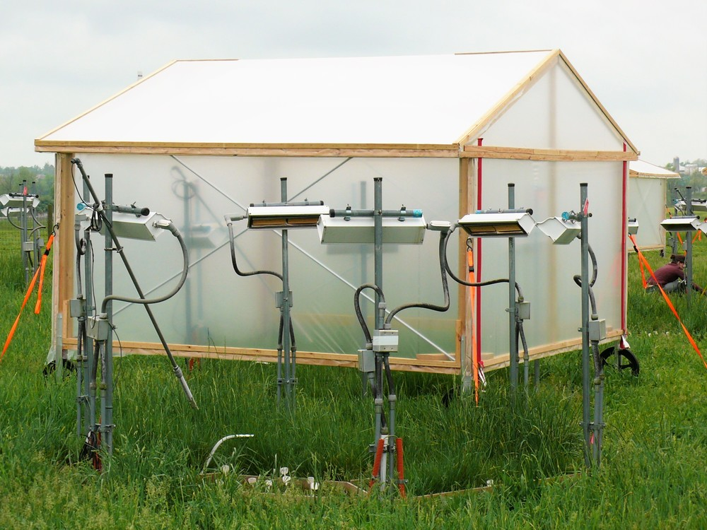 Climate manipulation in action! Moveable shelters cover half of the plots during precipitation events; precipitation is added at scheduled intervals to mimic a decrease in frequency and increase in intensity in rainfall. Infrared heaters heat plots 5 C above ambient temperatures.