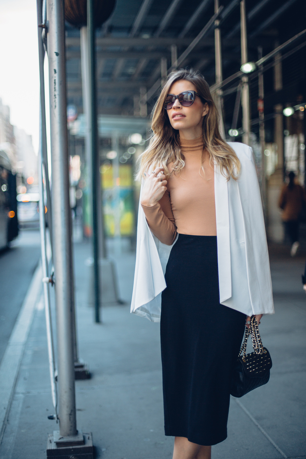 "Cape: Nasty Gal, Similar | Skirt: Aritzia, Similar | Top: Topshop | Bag: Rebecca Minkoff | Pumps: Sam Edelman | Sunglasses: Elizabeth&James | Watch: Daniel Wellington | Lipcolor: Charlotte Tilbury in ""Stoned Rose"""