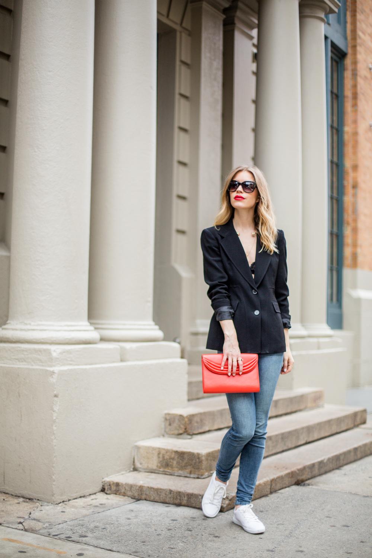 black blazer bold red clutch