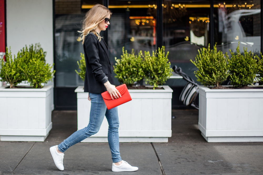red clutch white sneakers