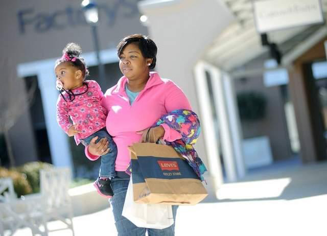 Shariba Wash and her daughter Shamya, 18 months, both of Forest, enjoy an afternoon shopping excursion at the Outlets of Mississippi in Pearl on Tuesday.