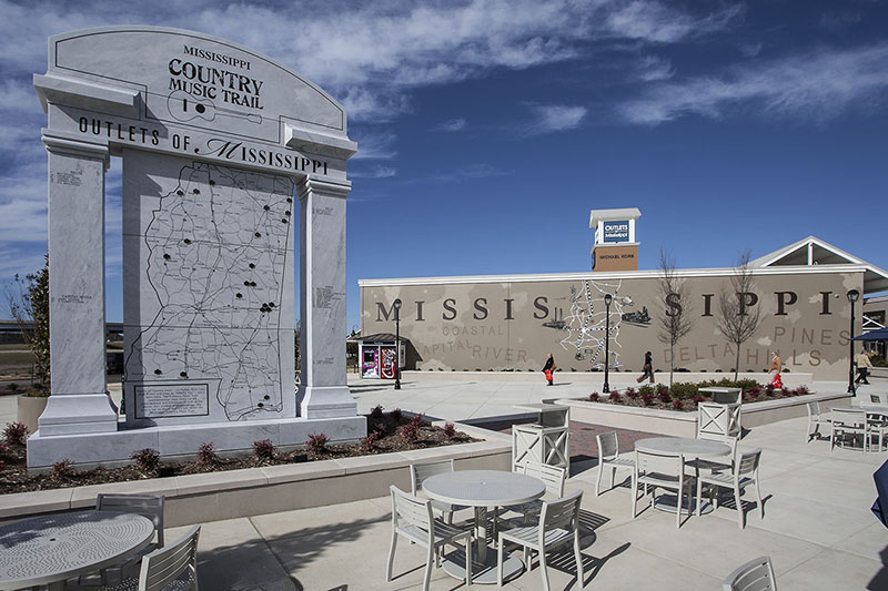 Spectrum Capital, developer of the Outlets of Mississippi, successfully applied for tourism status for the project, which enabled the center to receive a $24 million tax rebate. The sculpture, above, features Mississippi's country musicians on one side and blues musicians on the other.