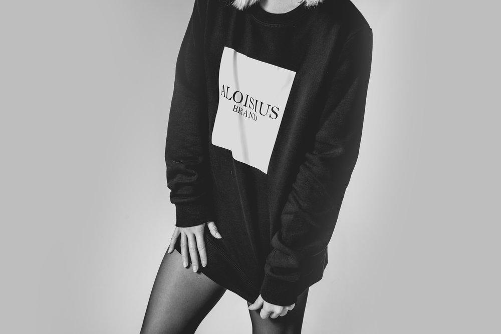 Woman wearing an Aloisius sweatshirt
