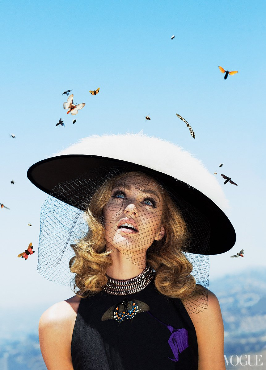 vogue :       You may be opting for an extra-large hat this summer if Candice Swanepoel has anything to say about it.        Photographed by Alex Prager