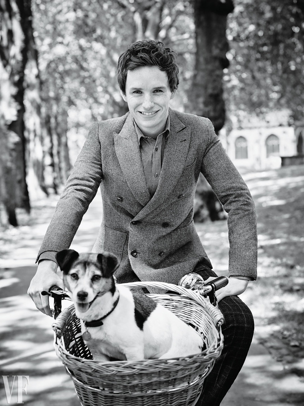 Eddie Redmayne + Puppy in a Basket.     You're welcome.    Photograph by Jason Bell.