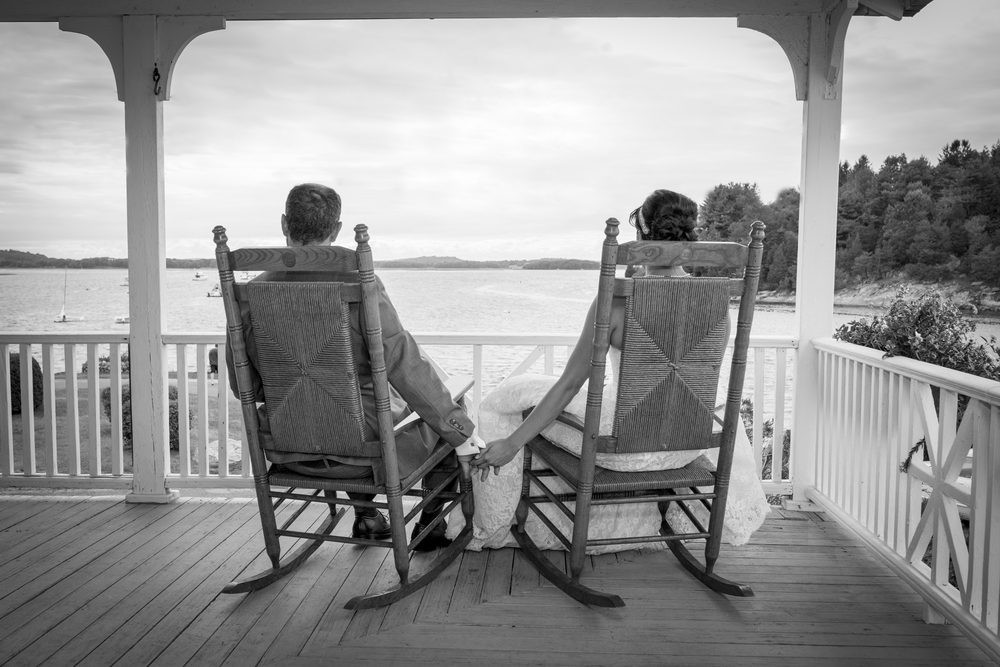 wedding rocking chairs ocen side holding hands .jpg