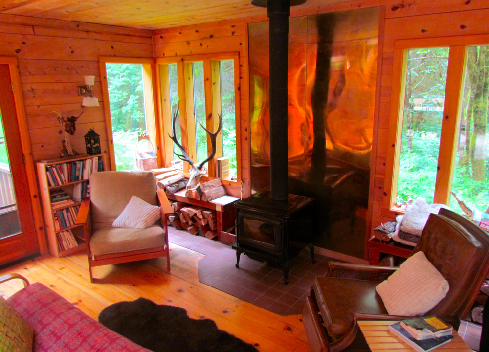 Here is the cozy living room with a woodstove