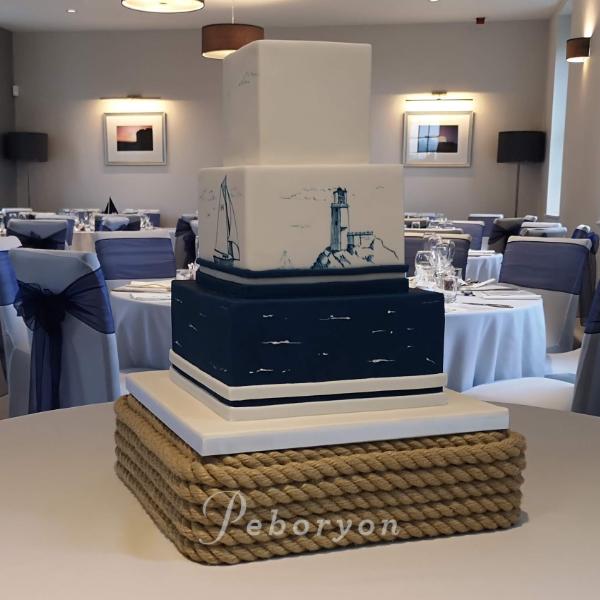 phil_jensen_christine_jensen_peboryon_cornwall_wedding_cake_nautical_painted_pendennis_castle.png