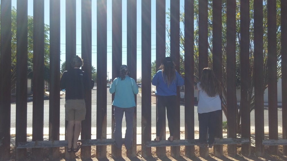 The 2016-17 Denver Dwellers visit the Mexico border as part of a week of learning about immigration.
