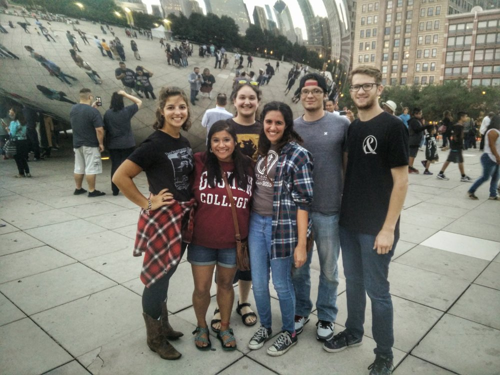 Dwellers (L to R) Meredith, Gladys, Evelyn, Emily, Luke, & Kyle visit the reflective Bean in downtown Chicago during a community day.
