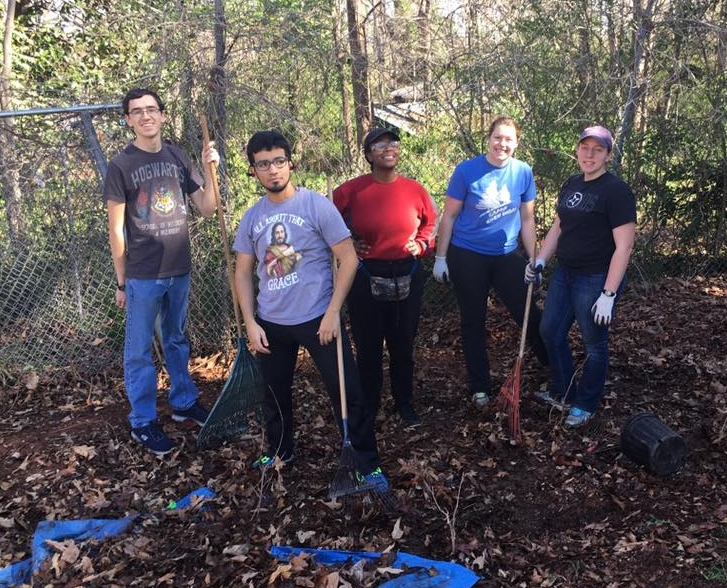 A spring break college group in Atlanta helps prepare an urban garden for planting season.