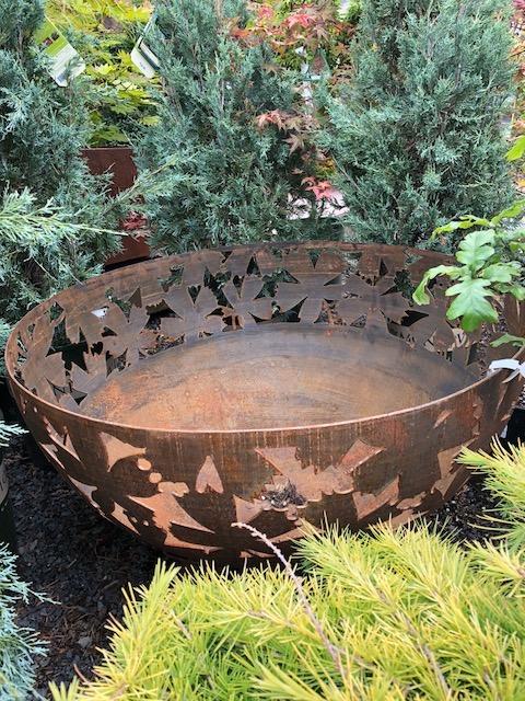 Rustic leaf pattern fire pit.jpg