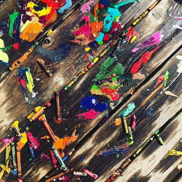 If you've ever wondered what it looks like when your kids dump a bunch of crayons out on the back deck and leave them there for a day or two, here's your visual. I'd be lying if I said I didn't kind of love it. I guess it's all those years of art classes... 😜 #deckart #meltedcrayons #principlesandelements #artbyaccident