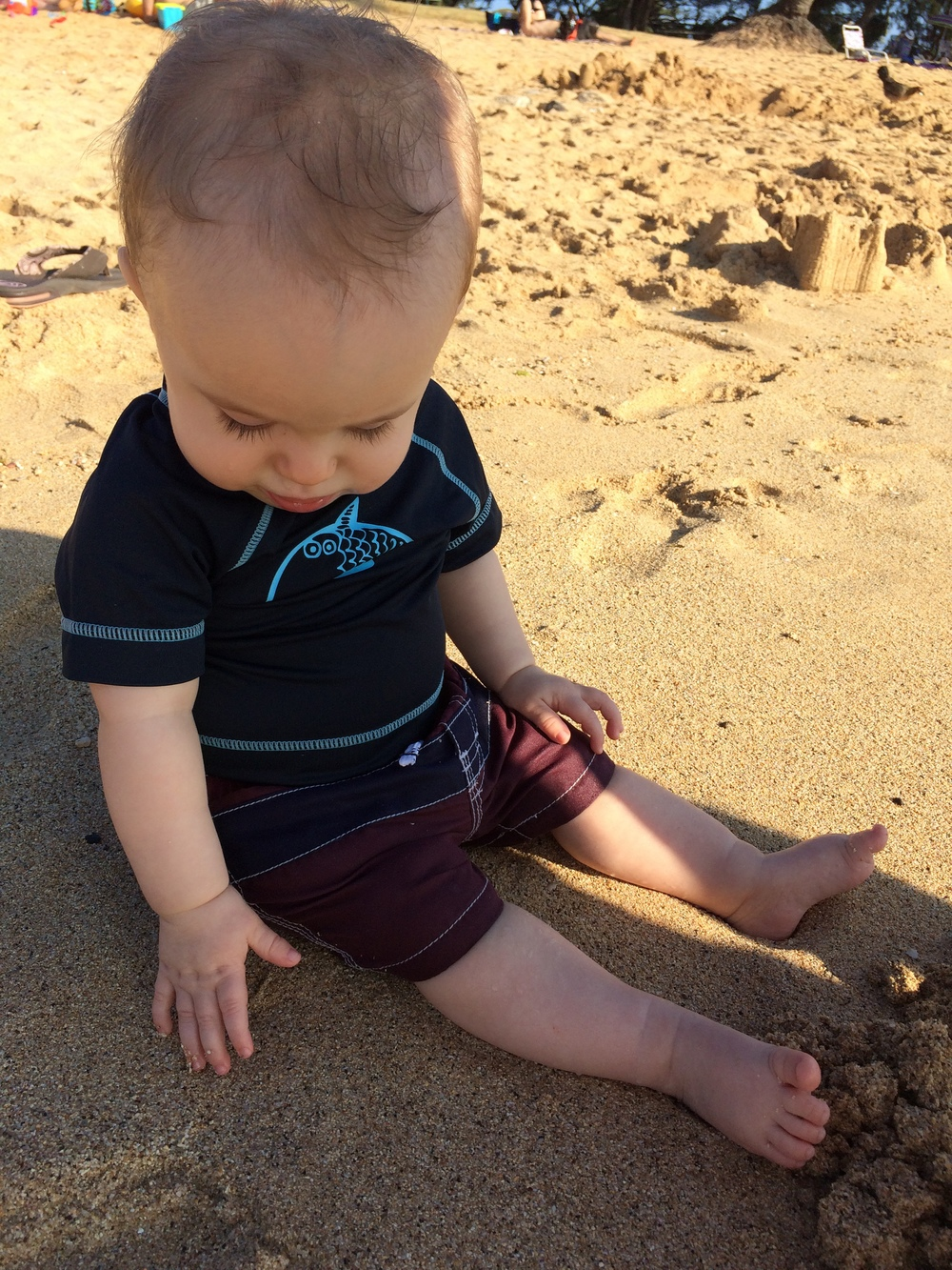 playing in the sand at Poipu.