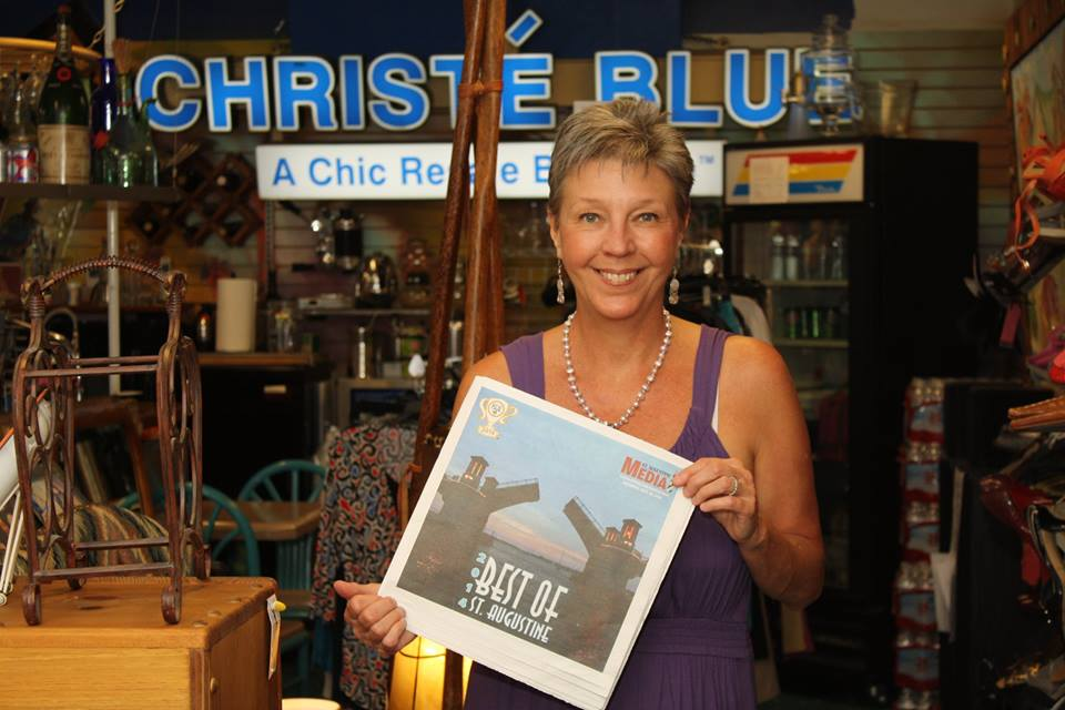 "Susan celebrating Christé Blue's third consecutive win for ""Best Consignment Shop"" in the 2014 Best of St. Augustine annual awards."