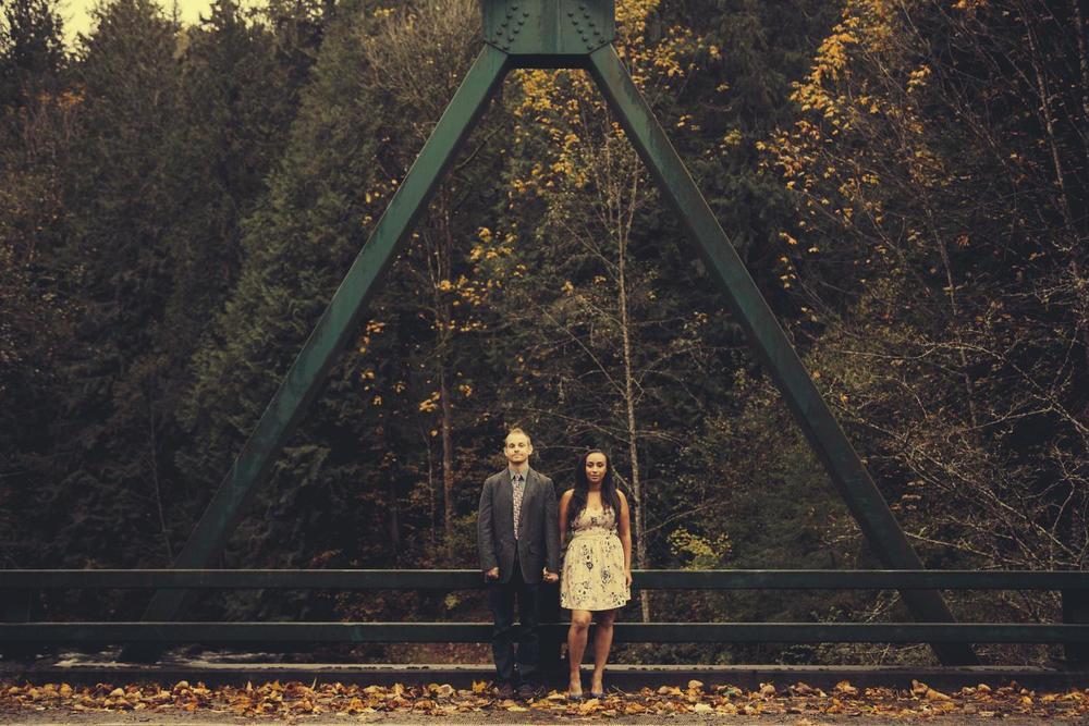 Chad andKeishanna pose on a bridge.