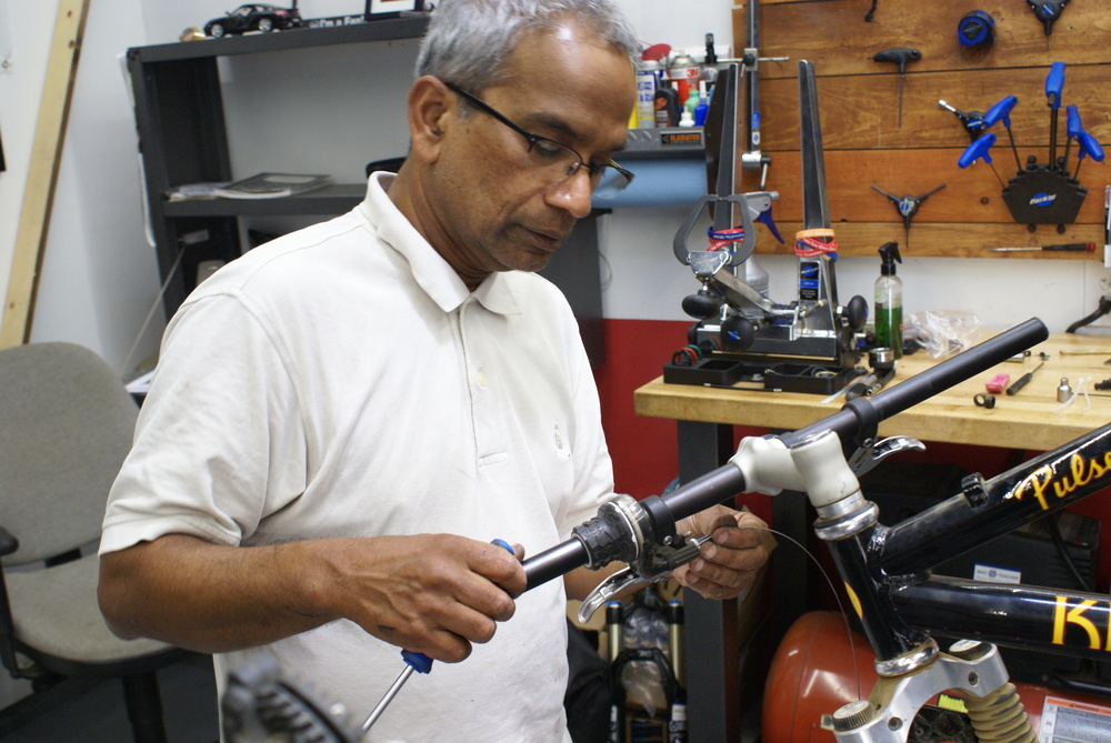 Shankar taking the 40 hour class, stripping and rebuilding his 90's model Klein Pulse mountain bike. July 2016