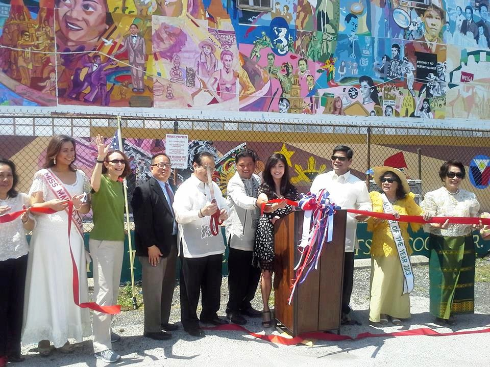 Cutting the ribbon at the dedication of the First Filipino American mural on the East Coast.