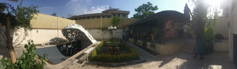 The courtyard of the school villa set up by Alireza Taghaboni with the swimming pool auditorium on the left.