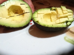 Cut avocado while still in flesh
