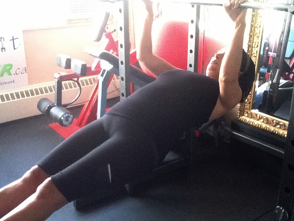 Maria performing an inverted row.  At 55 and a mom of 2!