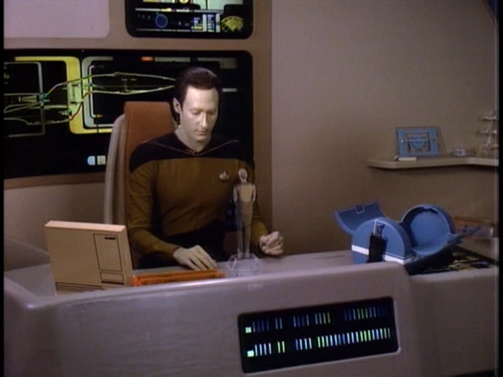 Commander Data taking a moment to remember Tasha Yar.