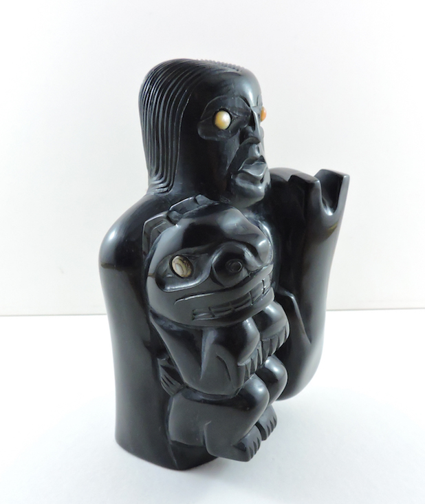 This argillite piece represents the Haida Bear Mother Story and is carved by Haida Artist, Michael J. Brown. This piece can be purchased on our website.
