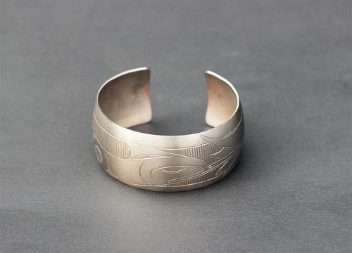 Haida Hummingbird Titanium Bracelet:  http://www.crystalcabingallery.com/shop/haida-jewellery/haida-hummingbird-titanium-bracelet
