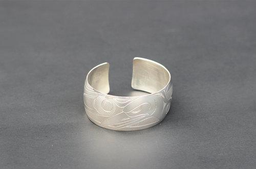 Haida Raven Silver Bracelet: http://www.crystalcabingallery.com/shop/haida-jewellery/haida-raven-silver-bracelet