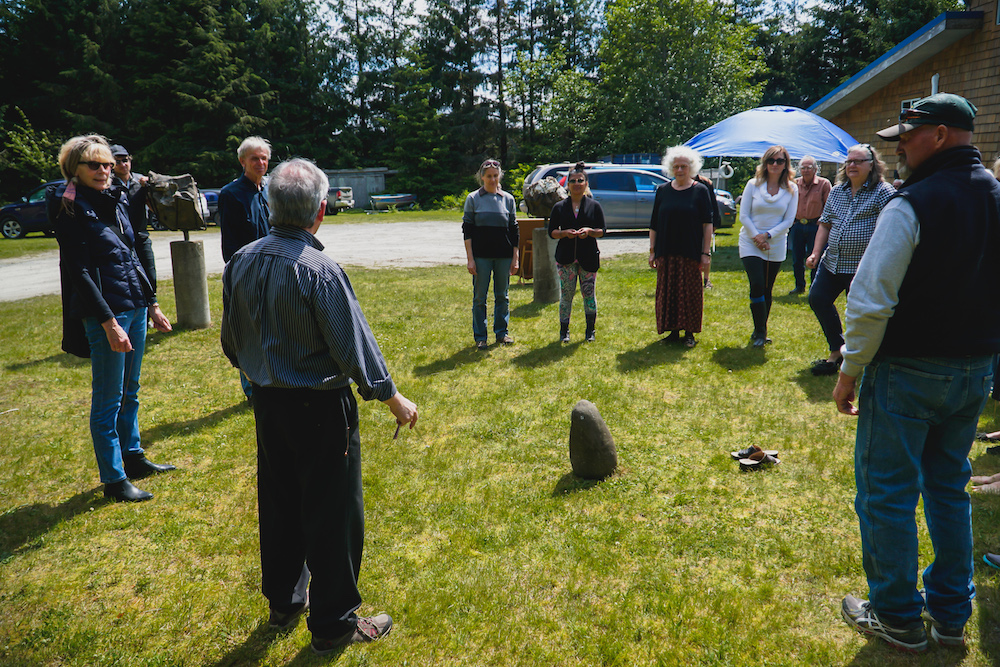 Neil Blacklock instructs guests in an exercise in dowsing - using copper rods one can detect the energy ley lines intersecting the Tlell Stone Circle! Photo by Patrick Shannon / www.innonative.ca