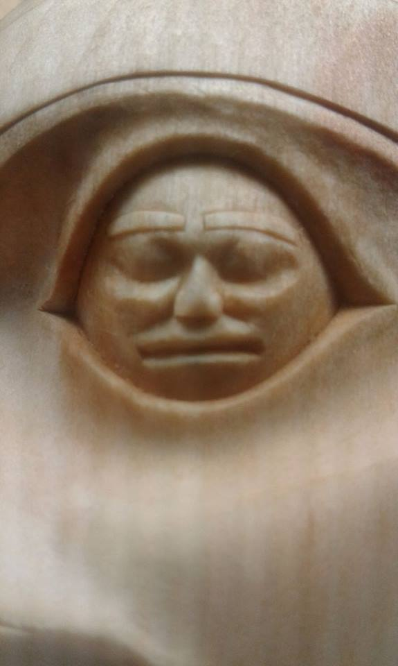 A close-up of detailed carving within the eyes.
