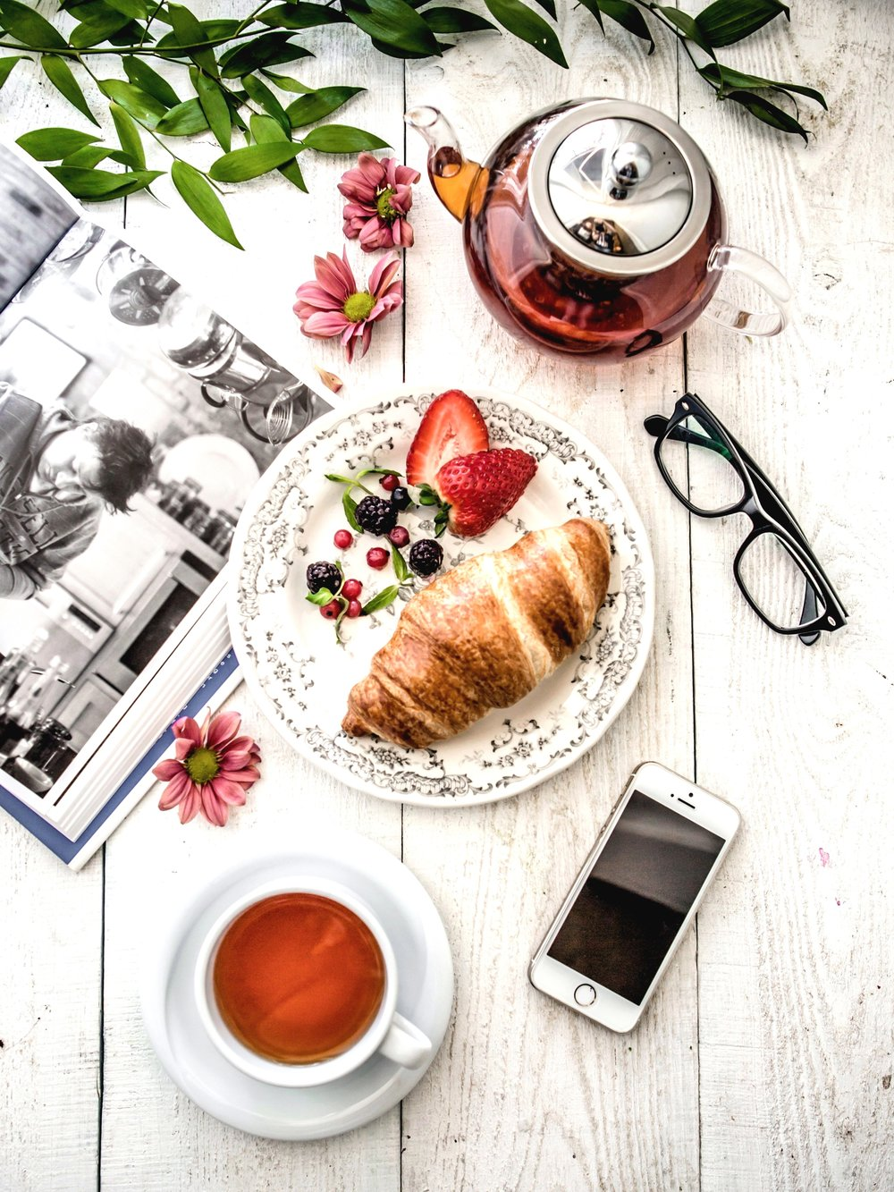 foodiesfeed.com_relaxing-with-book-tea-croissant-and-berries.jpg