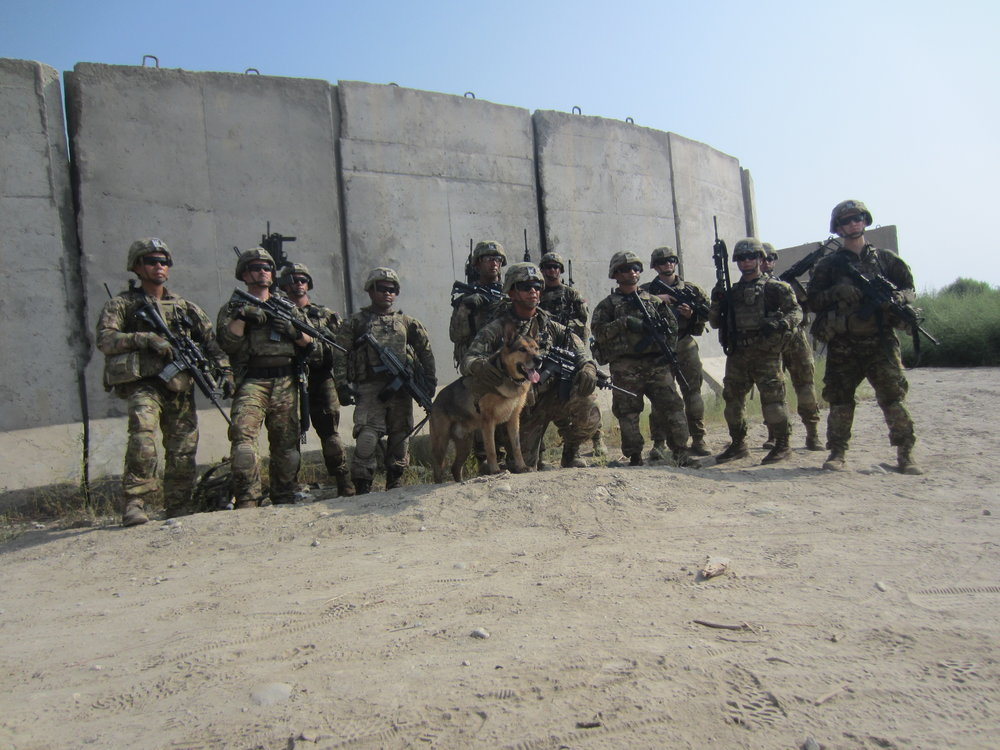 1LT Brehany's platoon poses for a picture with after a mission in Afghanistan (1LT Brehany on far right).