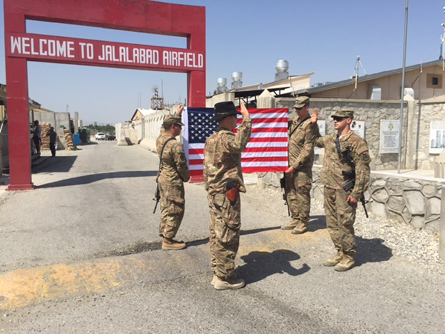 1LT Brehany re-enlists a soldier at Jalalabad Airfield in Afghanistan.