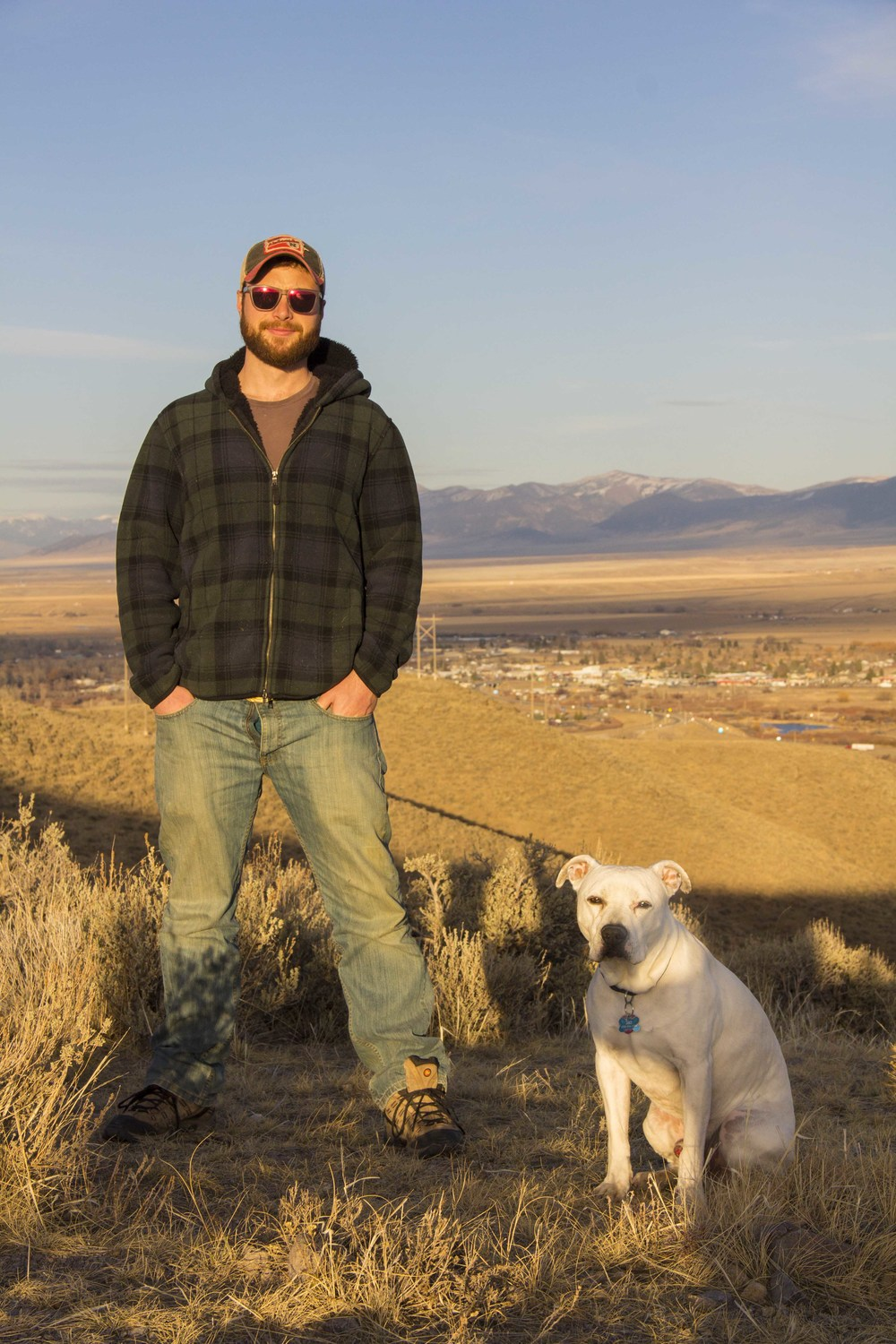 Chris Carparelli takes a break with his dog Jibz while hiking to the Dillon Town Overlook.